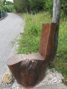 A wooden seat handily placed before the climb up to the new cemetery